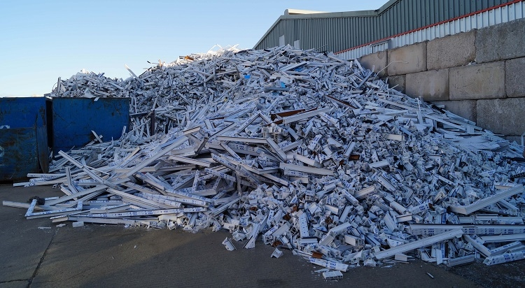 PVC window frames collected for recycling at Recovinyl.jpg