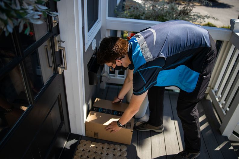Delivery driver placing package on front porch_i.jpg
